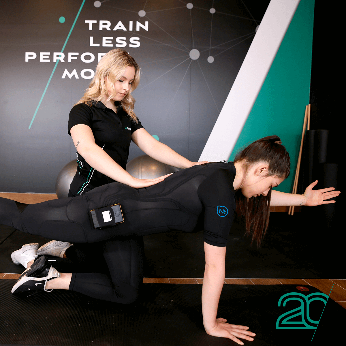 Woman Doing Core Exercises with the Help of a 20PerFit Personal Trainer