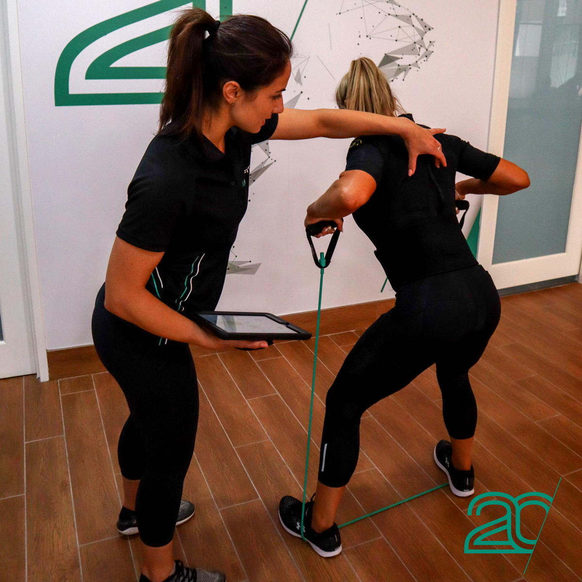Woman Exercising with a Rubber Rope Using 20PerFit's EMS Technology