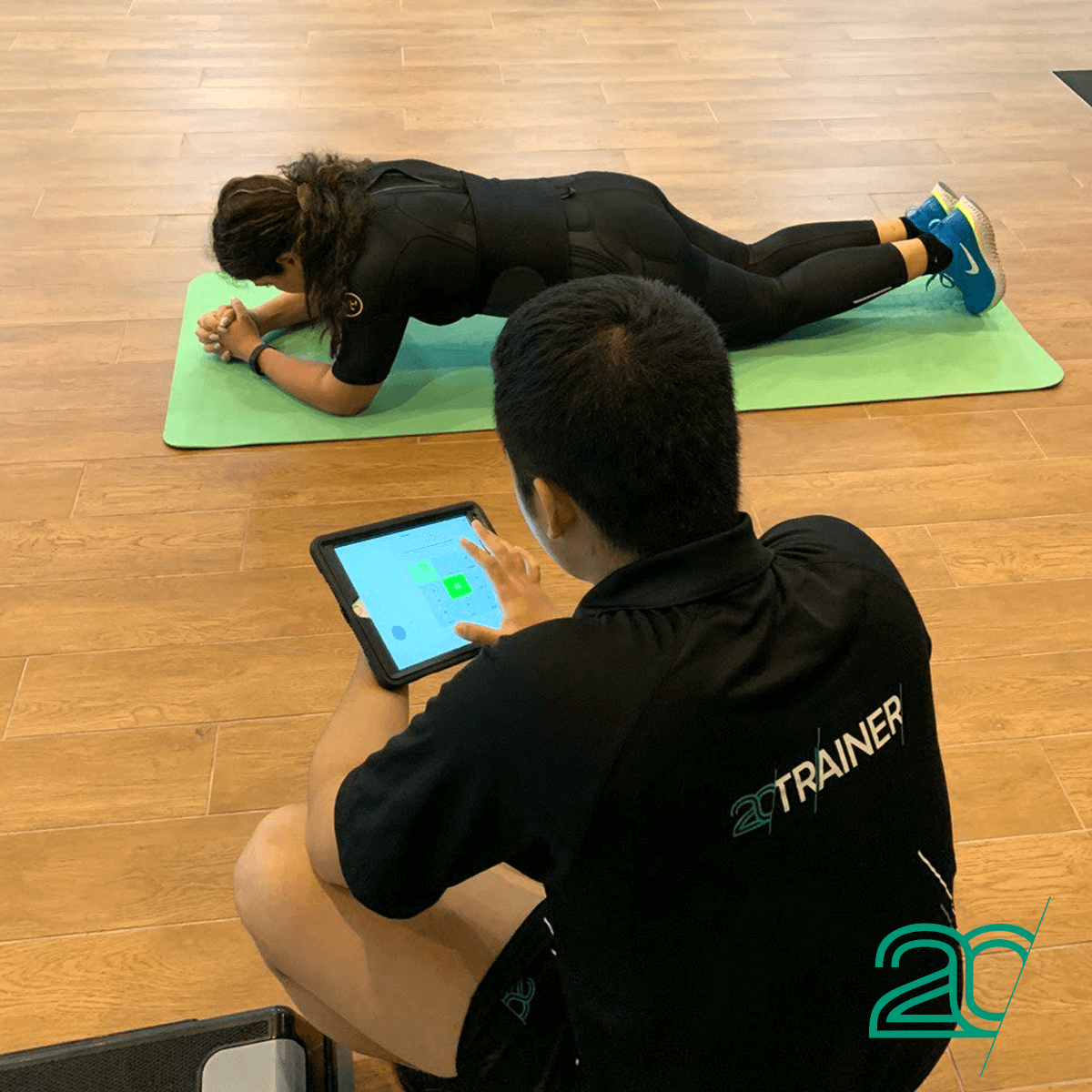 Woman Doing Core Exercises with a 20PerFit Personal Trainer