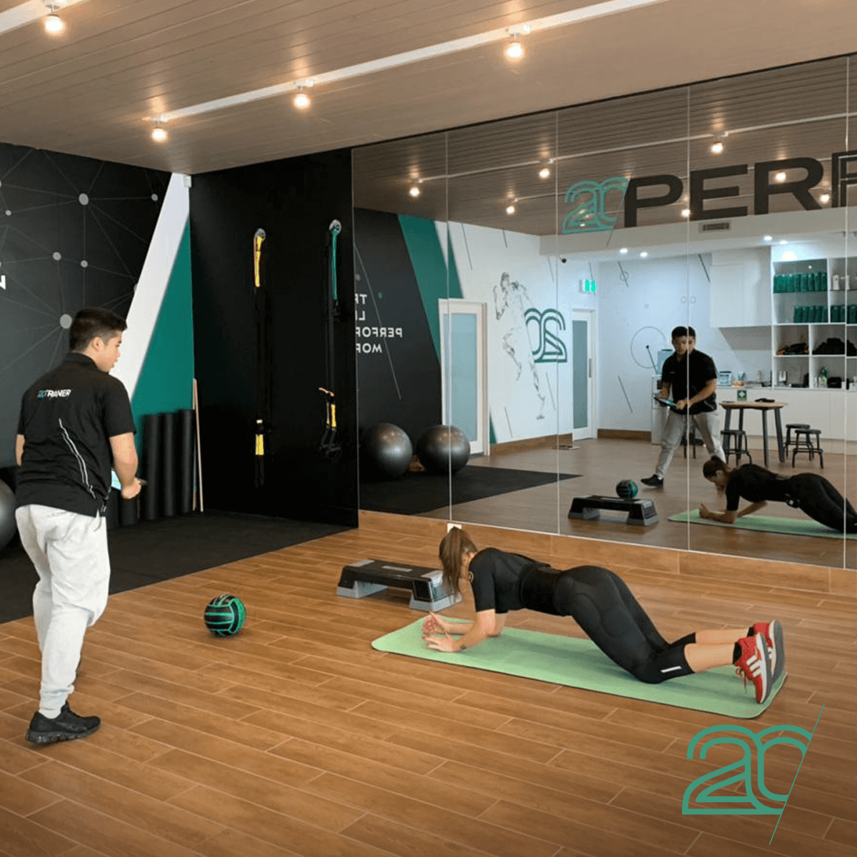 Woman Doing Core Exercises at 20PerFit's Gym Using EMS Technology