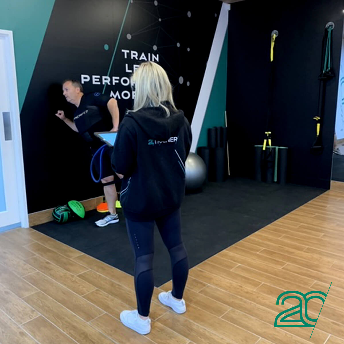 20PerFit Personal Trainer Doing Training her Client