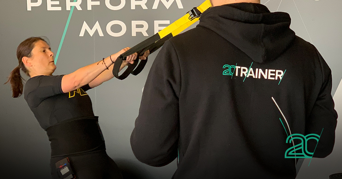Woman Working out in a 20perfit studio by a 20perfit trainer