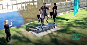 group of people training outside with a 20perfit trainer